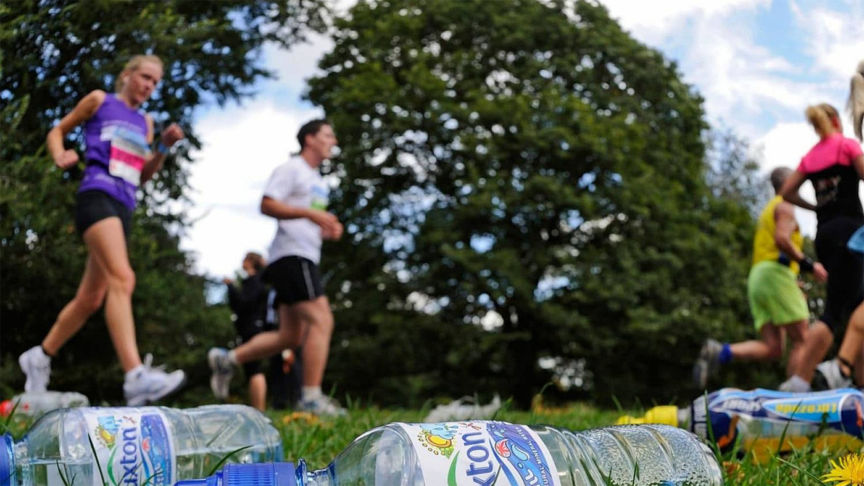 Runners run by discarded bottles